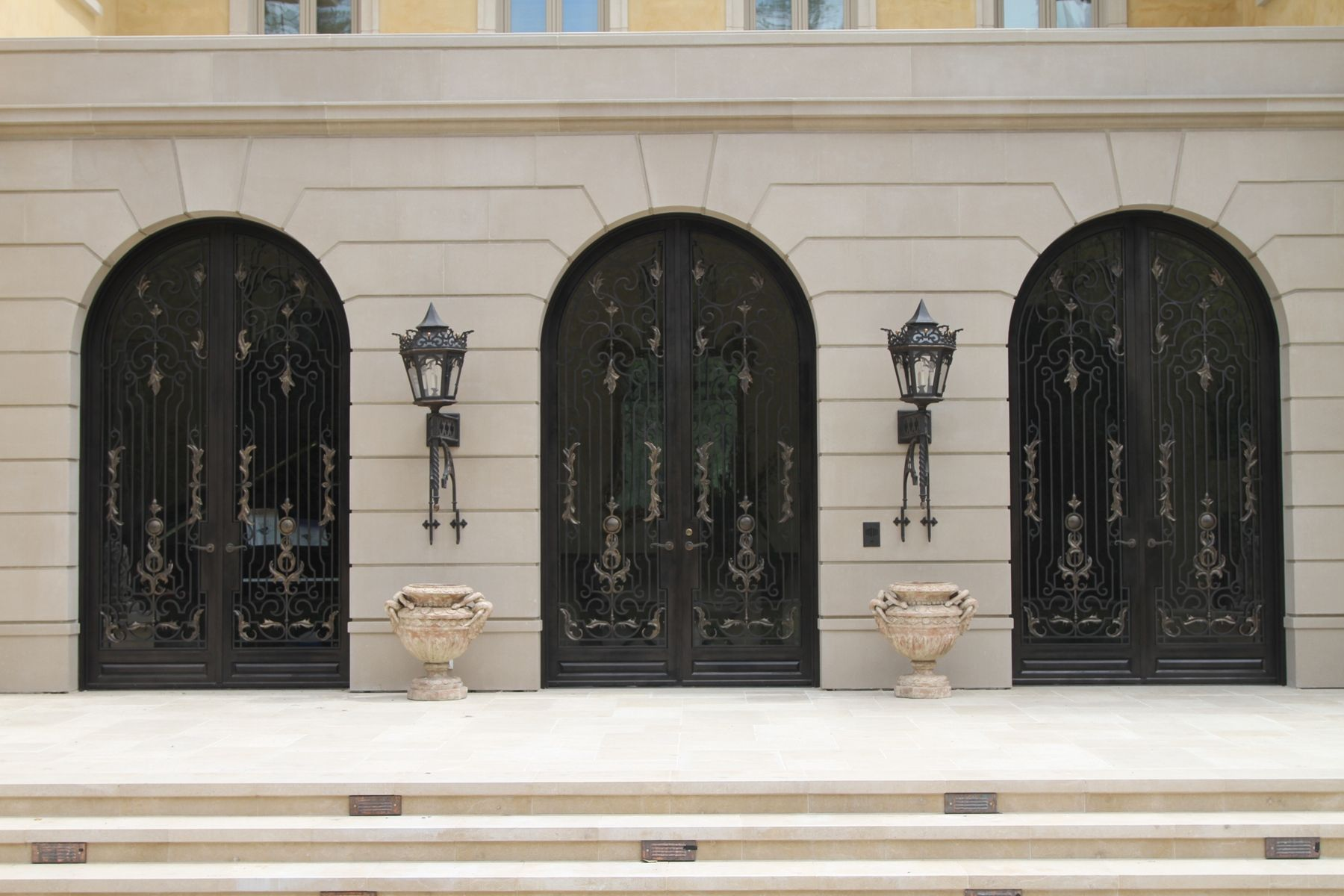 Hand crafted hand forged wrought iron front entry french for Custom made exterior steel doors