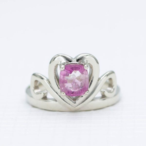 A tiara-inspired promised ring in white gold with a cushion cut poudretteite center stone.