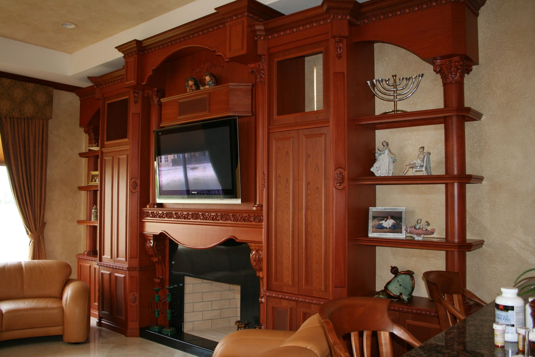 hand crafted cherry fireplace unit by lasting impressions