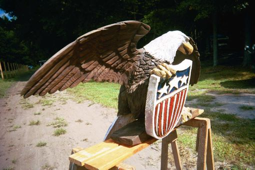 Custom made chainsaw carvings birds by artisans of the