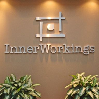 Custom Made Inner Workings Lobby logo in brushed stainless steel