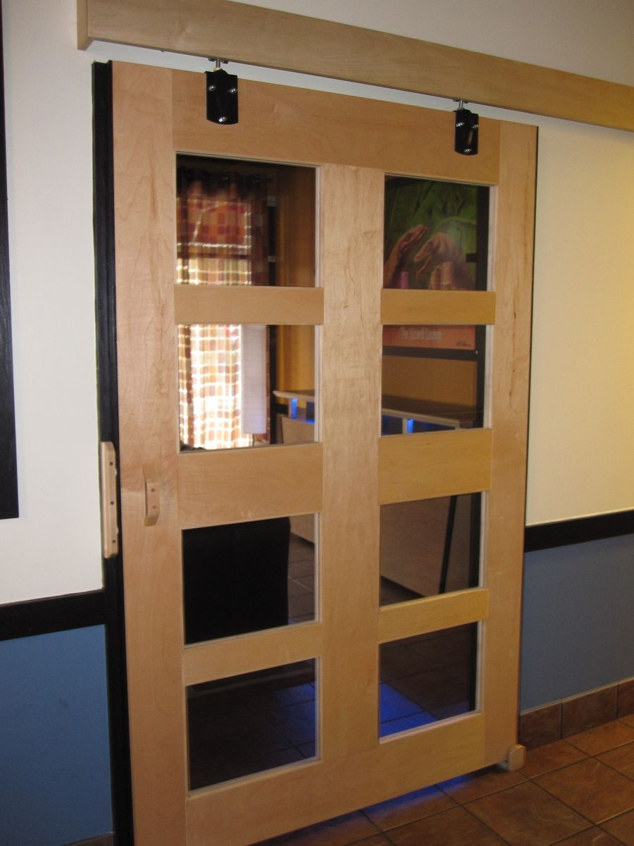Hand made maple sliding barn door by boltonwoodworking for Custom made wood doors