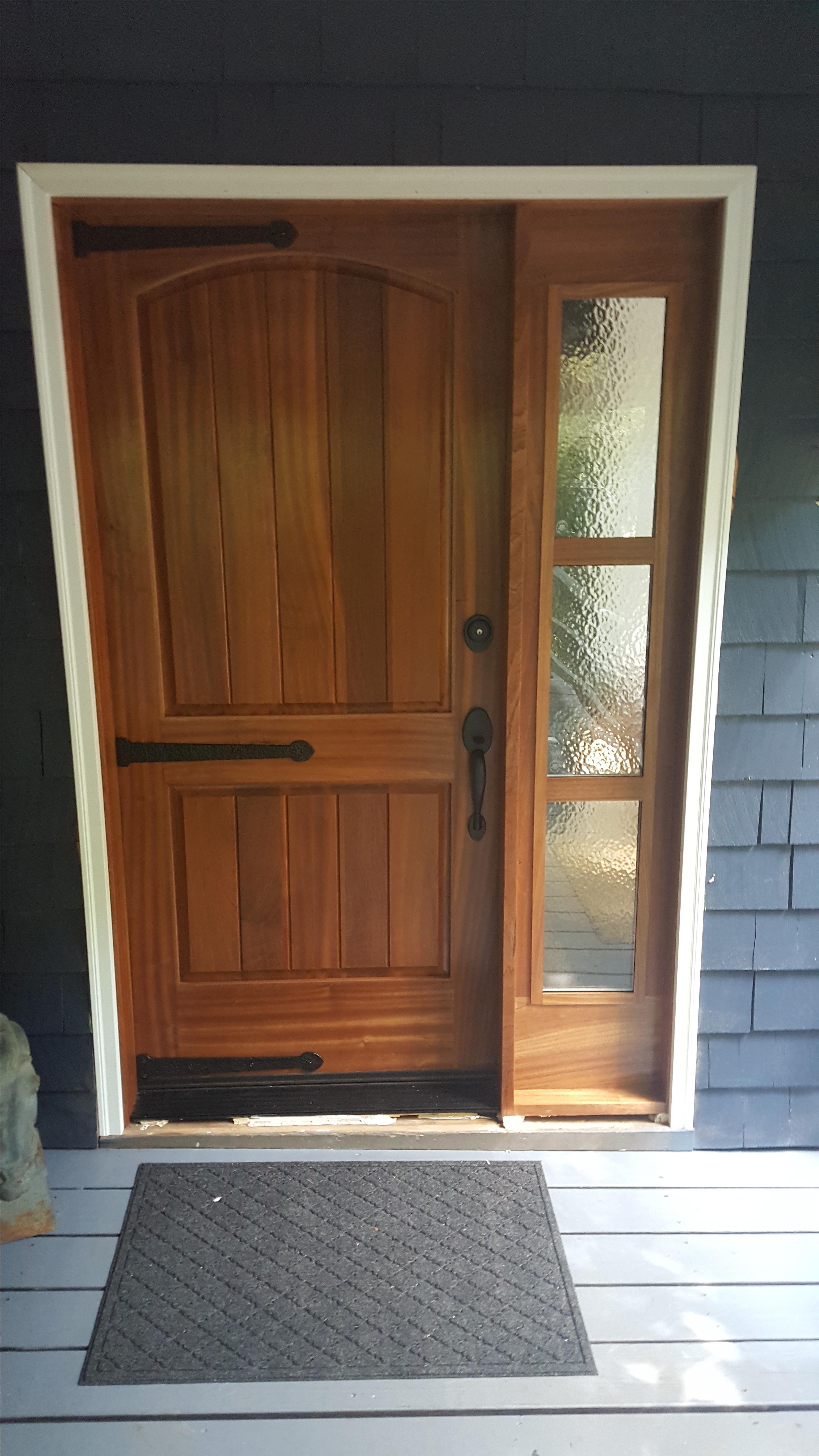 Custom made sapele exterior door with triple glass sidelight