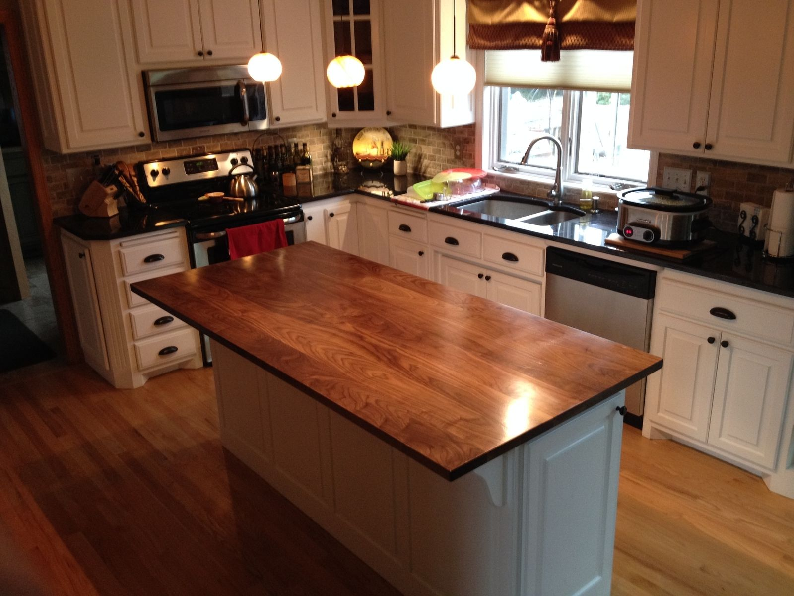 hand crafted solid walnut kitchen island top by custom ForCustom Made Kitchen Islands