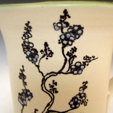 Custom Made Pottery Mug With Small Flowers In Black And Blue
