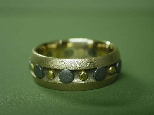 Custom Made Rose Gold Wedding Ring With Titanium And Pure Gold Rivets.