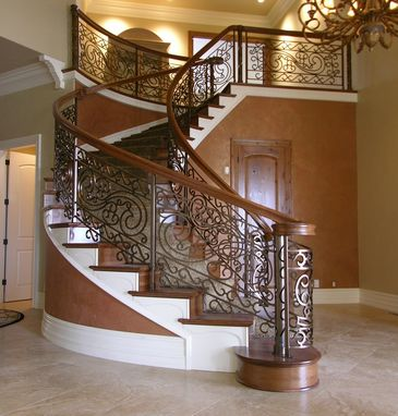 Custom Made Iron And Cherry Curved Staircase