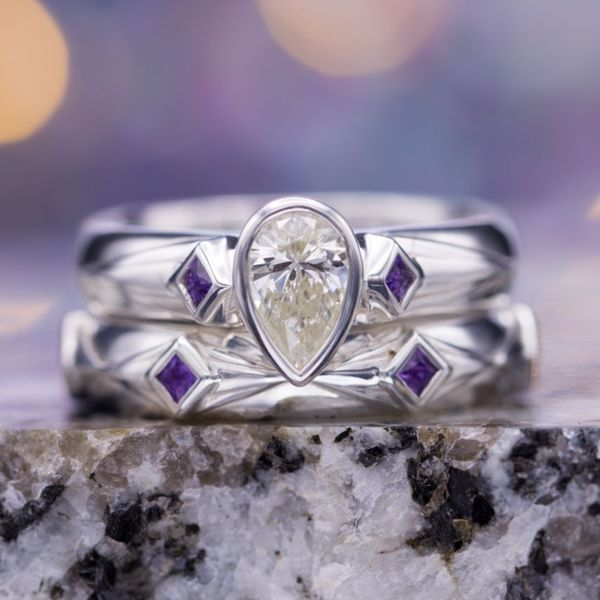 Amethysts in diamond-shaped bezel settings layered on elongated diamond shapes lend the bands in this bridal set a beautiful and subtle geometry.