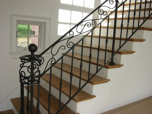 hand crafted custom interior wrought iron railing by amaral industries