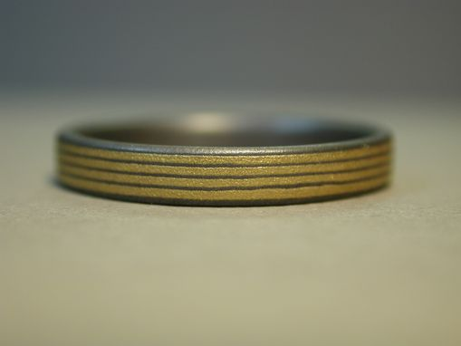 Custom Made Titanium Wedding Ring With Pin Stripes Of 24k Gold
