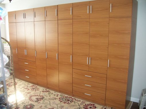 Custom Made Honey Maple Matte Finish Complete Wall Wardrobe Closet/Storage Solution With A Custom Look And Satin Finish Hardware