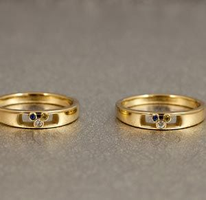 roberts bands a matching yellow gold wedding ring set for a couple featuring three birthstones in honor of their children - Rings For Wedding
