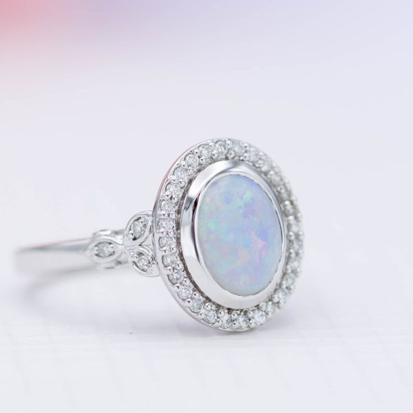 A white opal with predominantly blue color play.