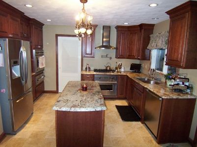 Custom Made Cherry Kitchen With Granite Tops