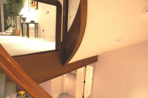 Custom Made Contemporary Curved Cherry And Glass Stair, With Integrated Wine Cellar
