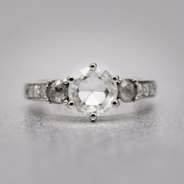 Embracing antique cuts: a 1ct rose cut diamond with rustic, rose cut salt-and-pepper diamond side stones and a channel of single cut round diamonds down the platinum shank.
