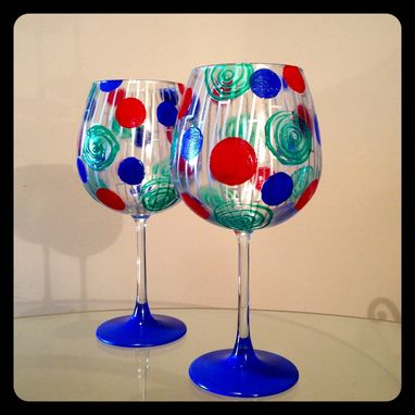 Custom Made Silver Design With Blue, Red, And Green Swirls. Red Wine Glasses.