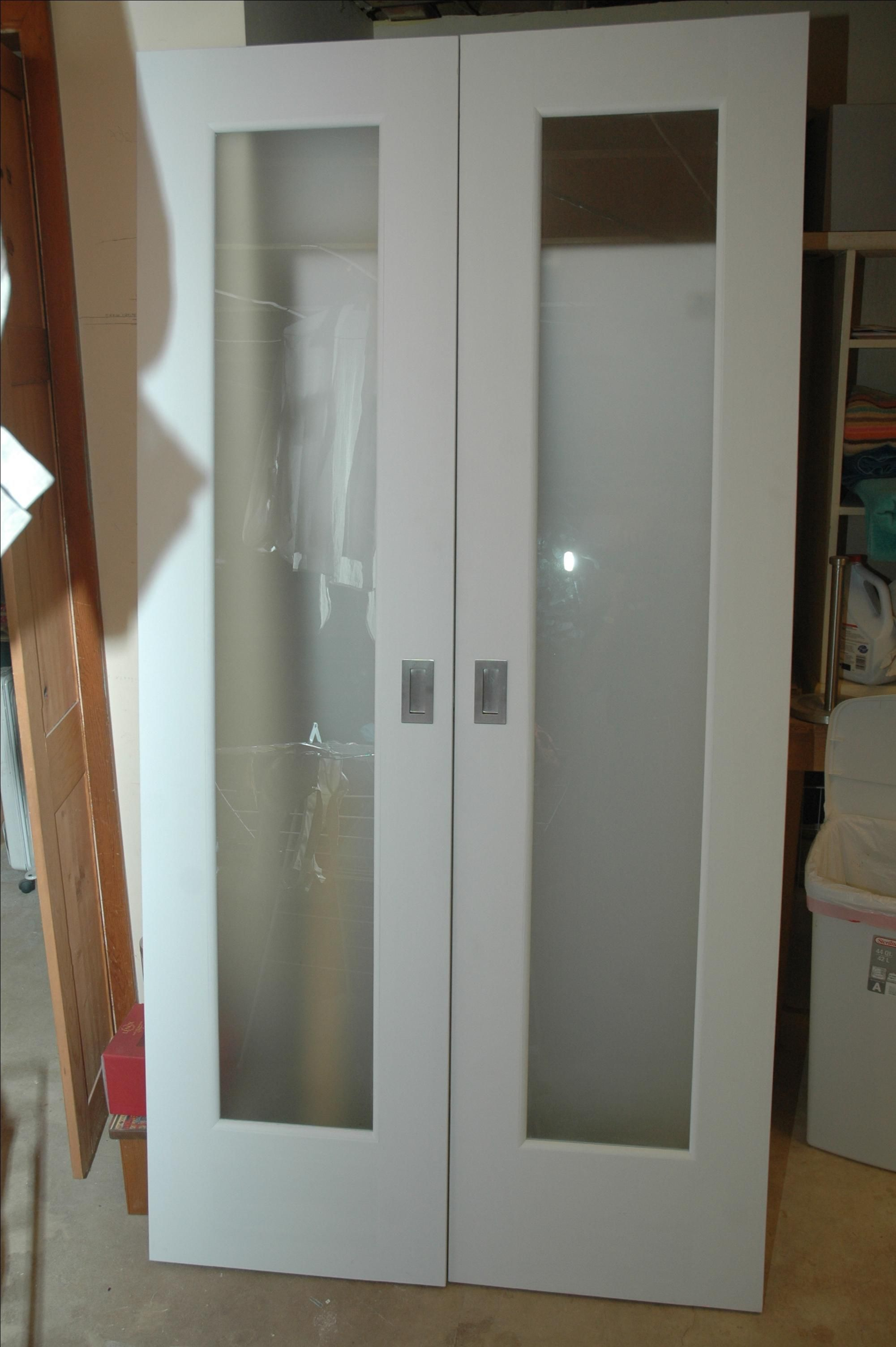 Handmade closet doors w frosted glass panels by wooden it for Custom made wood doors