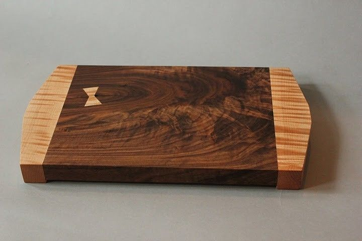 Handmade walnut and curly maple cutting board by reid eric