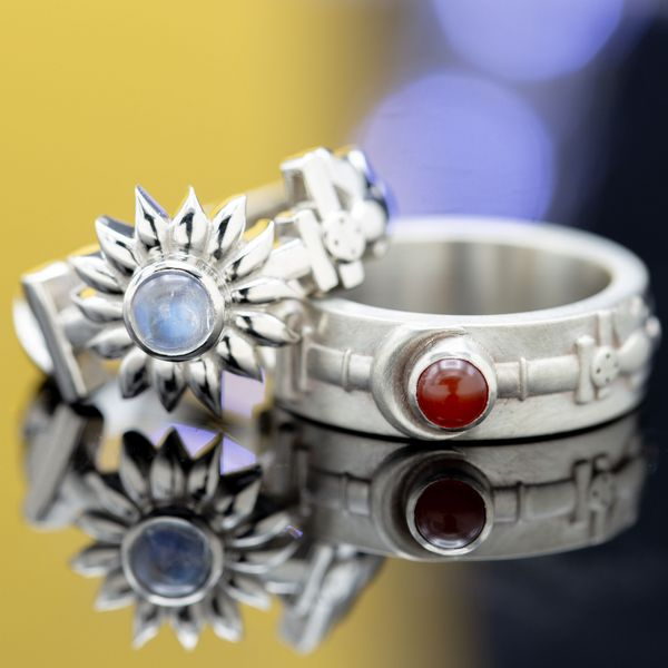 This unique ring set showcases a moonstone and a carnelian in unexpected roles in the rings' sun and moon theme.
