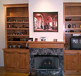 Custom Made Custom Bookcases & Cabinets Flanking Fireplace