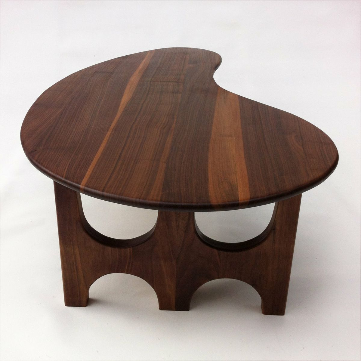 Buy a custom made coffeecocktail table with trident base made of custom made coffeecocktail table with trident base made of solid walnut kidney bean geotapseo Choice Image