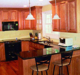 Kitchen With Black Granite Countertop