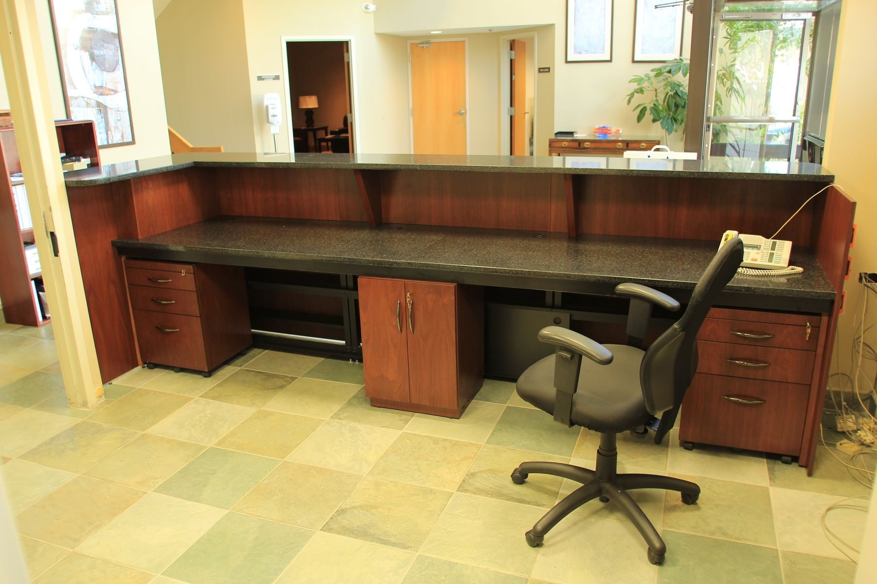 custom office desk. custom made zodiac and walnut reception desk office