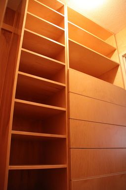 Custom Made Built In Closet With Walnut Floor