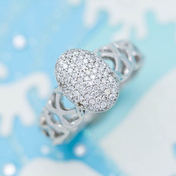 Inspired by a famous movie ring, this design sets a sparkly oval of micropave diamonds as its central feature.