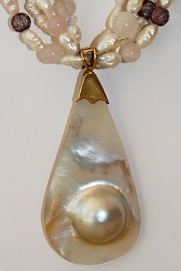 Custom Made 4 Strands Of Pearls, Stones And Crystals Surround This Large Mabe Pearl Set In Gold Pendant