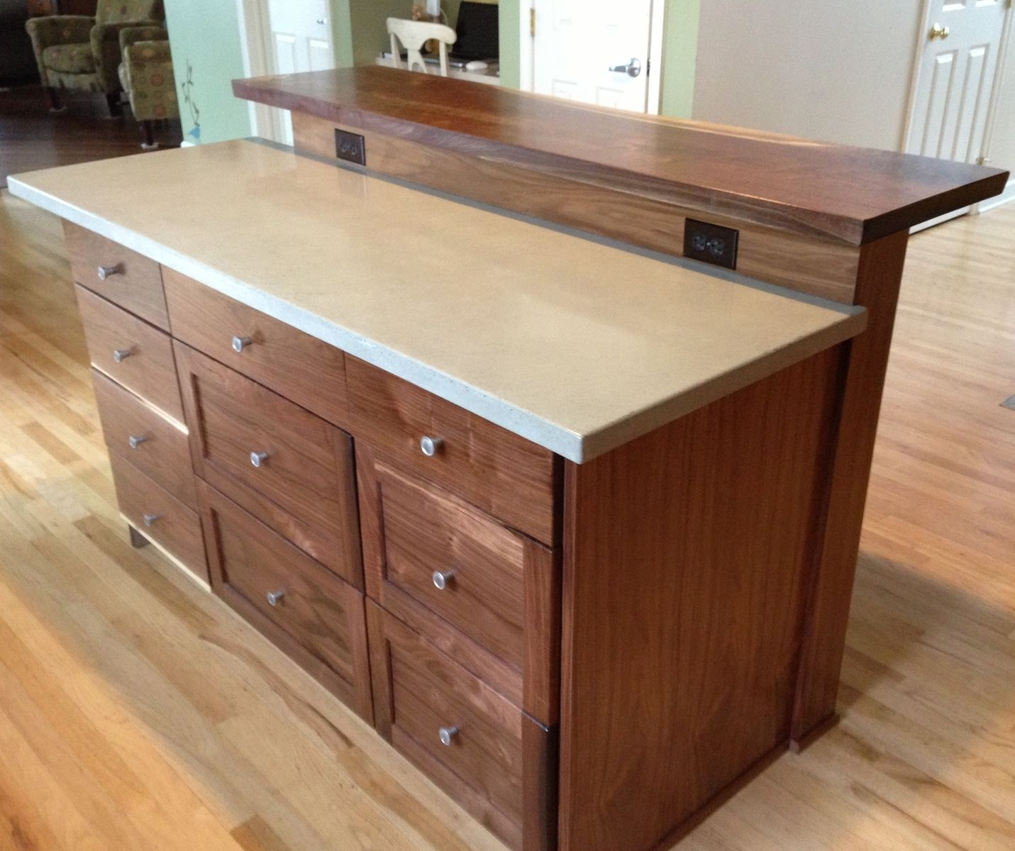 Custom kitchen island with slab bar top by saw tooth for Custom made kitchen islands