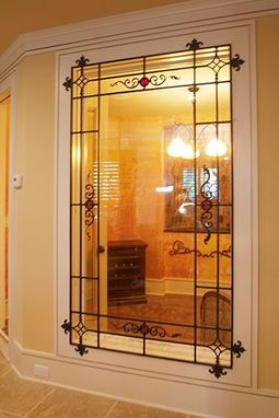 Custom Made Wine Cellar Window With Wrought Iron Grill