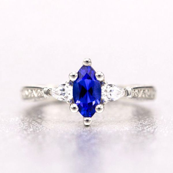 This engagement ring's marquise cut tanzanite has an intense, vivid blue color that pops against the diamonds and white gold of its setting.