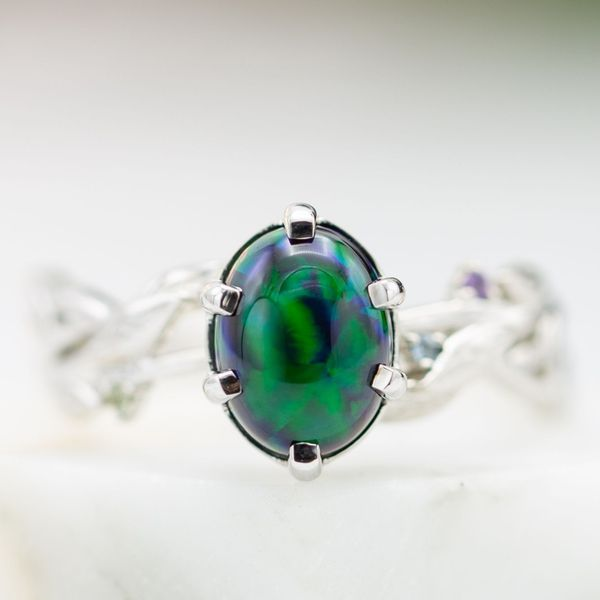 A black opal with rich, saturated blues and greens steals the show in this white gold engagement ring.