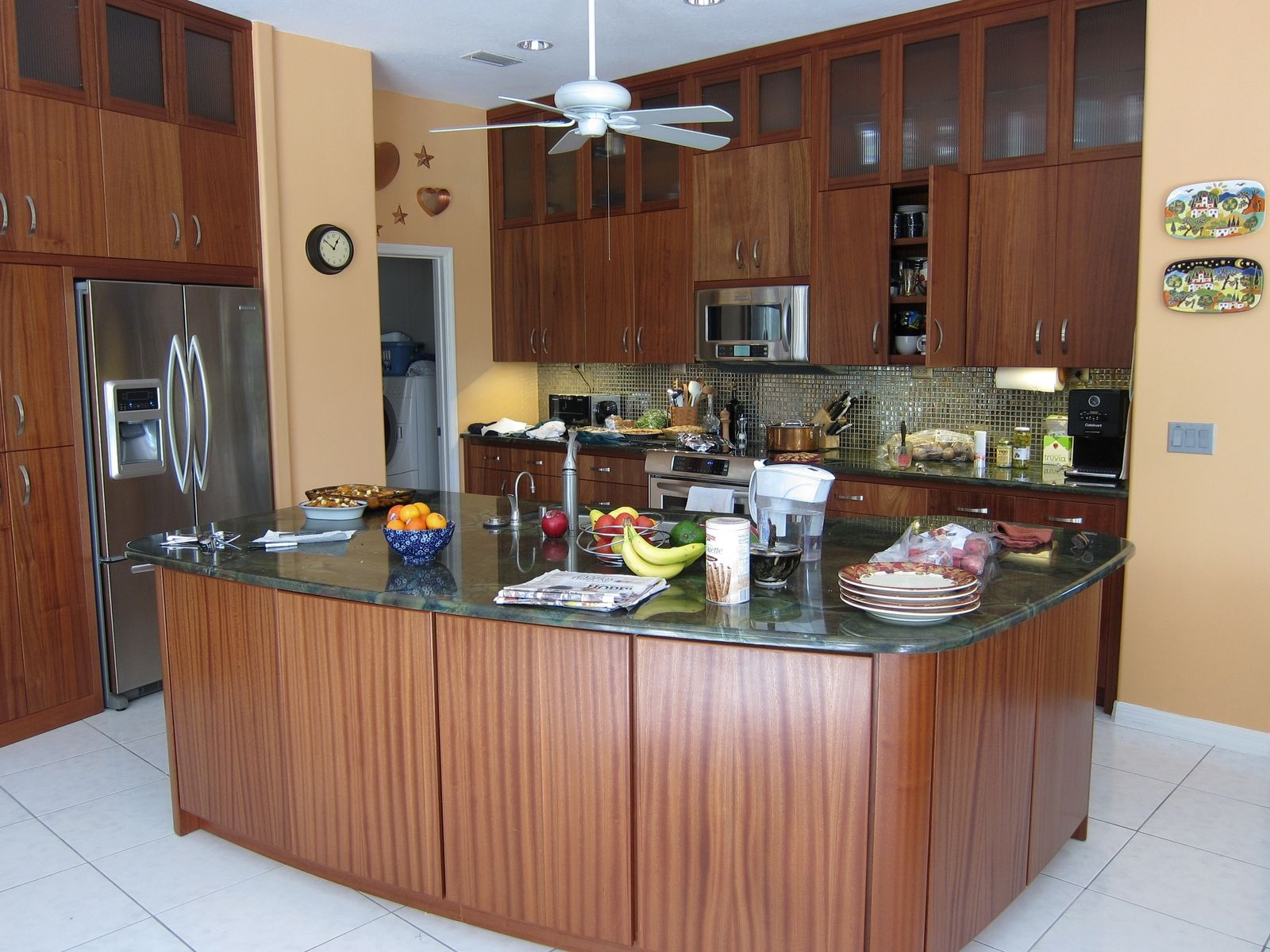 Custom sapele wood kitchen cabinets by natural designs inc for Custom built kitchen cabinets