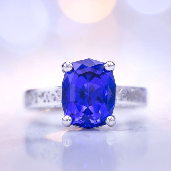 This tanzanite's blue would rival any sapphire. Precision cut in an elongated cushion shape, it's the star of this platinum engagement ring.