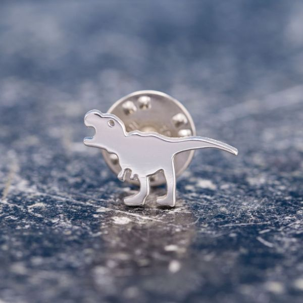 Designed with a bride-to-be for her fiancé and his 5-year old dinosaur-loving son. A sentimental and adorable t-rex pin.