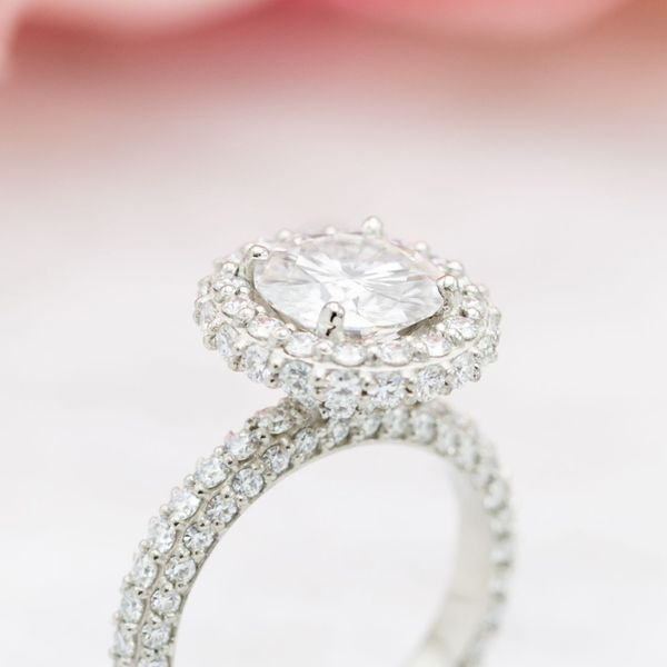 Every surface of this ring is diamond-encrusted, including a side halo on the outer edge and a standard halo facing up.