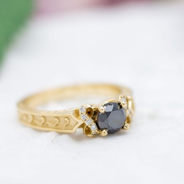 Black diamond infinity engagement ring with vintage styling.