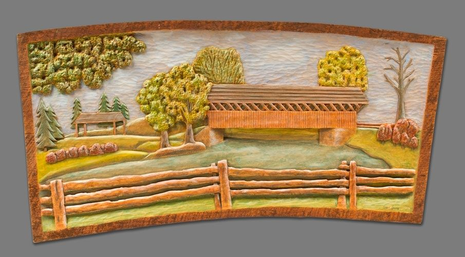 Custom made low relief carving of a covered bridge by fine