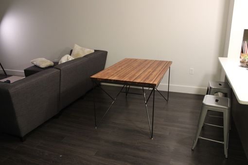 Custom Made Dining Table With Recycled Steel Base.