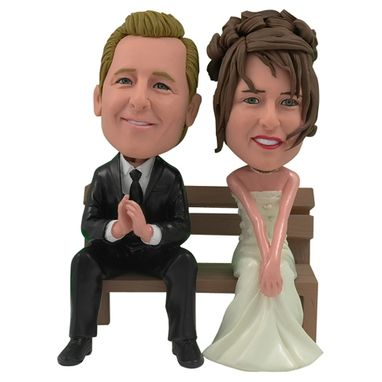 Custom Made Personalized Wedding Cake Topper Of A Couple On A Bench