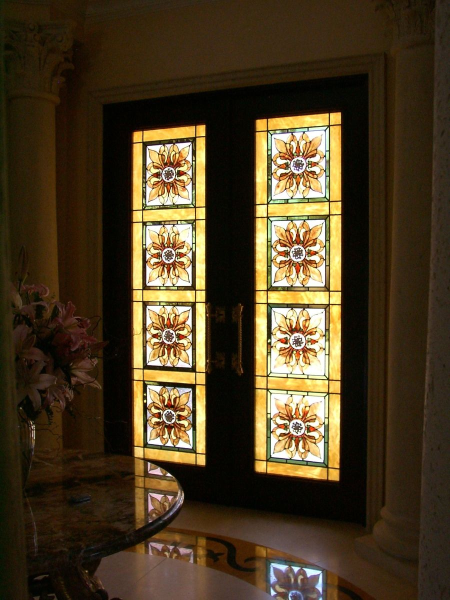 Handmade Entry Doors With Custom Stained Glass Panels Behind