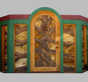 Custom Made Carved Entry Door And Sidelights With Stained Glass