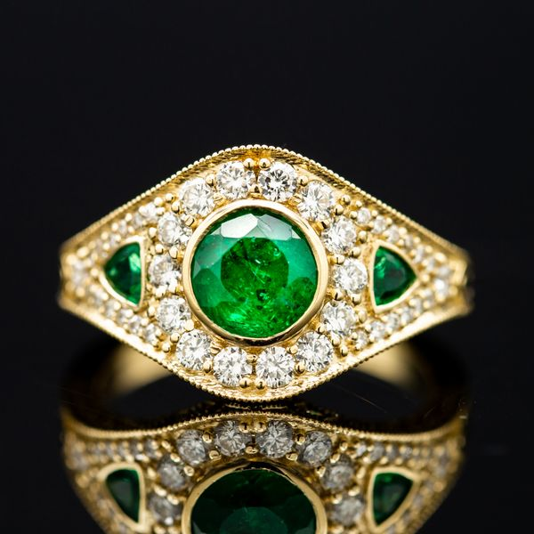 We created an Art Deco-inspired ring with diamonds and emerald accents as a new home for this vibrant heirloom emerald.
