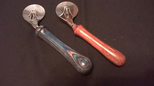 Custom Made Scoops, Pizza Cutters And Pens