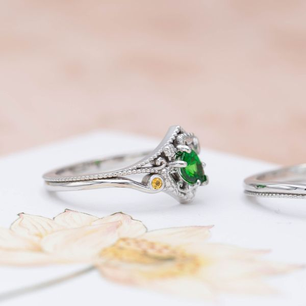 Bright accent gems and milgrain detailing add elegance in this turtle engagement ring.