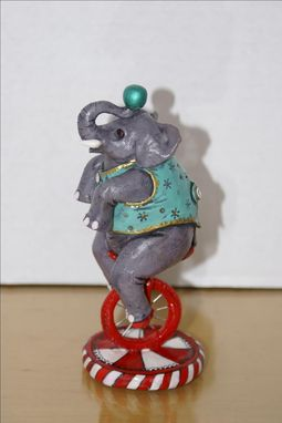 Custom Made Hand Sculpted Polymer Figurine Of Circus Elephant In Teal On Unicycle