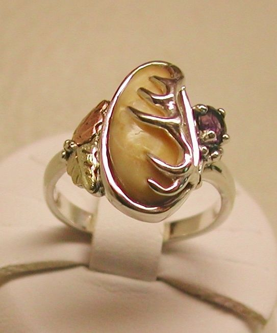 Some of the smaller teeth are lending themselves to this ladies ring. 4 mm round Amethyst stone and 10K pink & green gold leaves are adding interest t…
